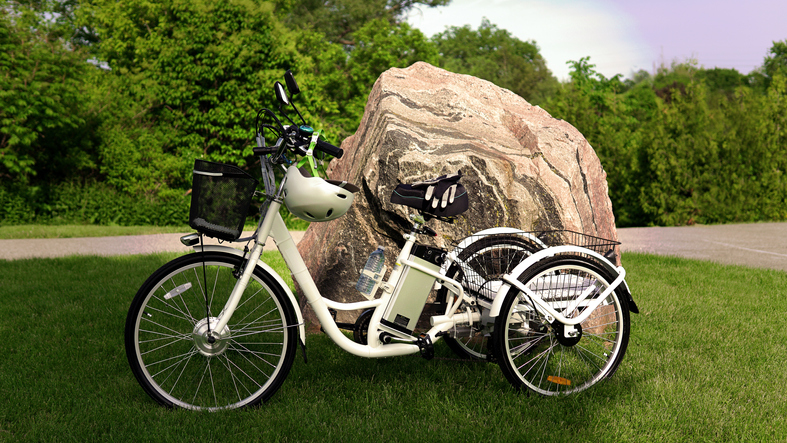 an electric tricycle parked on grass in front of a large rock